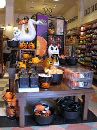 the ghost below left looks happy to be sporting festive mickey mouse halloween ears another ghost is ready for trick or treat below right